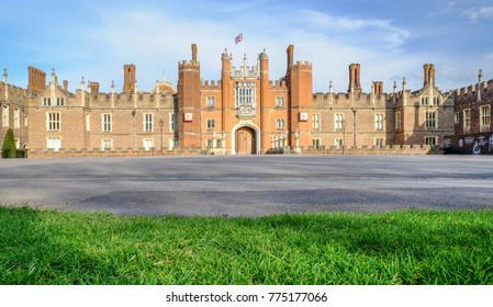 LONDON, UNITED KINGDOM - APRIL 11, 2017: Hampton Court Palace with blue sky. This palace was begun in 1515 for Cardinal Thomas Wolsey and seized by King Henry XII in 1529.