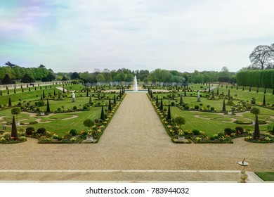 LONDON, UNITED KINGDOM - APRIL 11, 2017: Garden in Hampton Court Palace. This palace was begun in 1515 for Cardinal Thomas Wolsey and seized by King Henry XII in 1529.