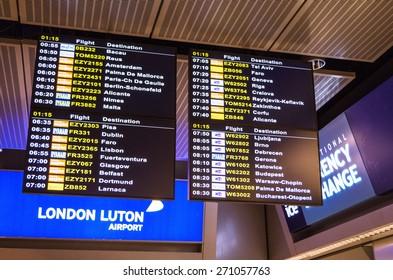 LONDON, UNITED KINGDOM - April 12, 2015: Airport departure board screen at Luton airport in London, UK