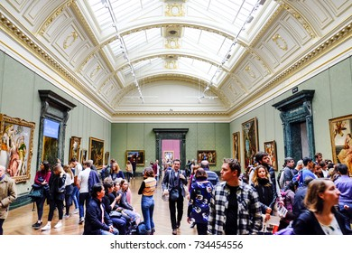 LONDON, UNITED KINGDOM - APRIL 14, 2017: Tourists in The National Gallery, London, UK . The National Gallery is an art museum founded in 1824, it houses a collection of over 2,300 paintings.