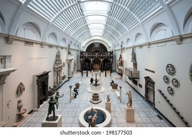 LONDON, UNITED KINGDOM - APRIL 16, 2014: People visiting Victoria and Albert Museum. V&A Museum is the world's largest museum of decorative arts and design.