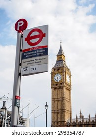 LONDON, UNITED KINGDOM - APRIL 16, 2015: The most famous London landmark Big Ben with the unique London underground sign. London is the world's most-visited city as measured by international arrivals.