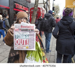 London, United Kingdom - April 16, 2016: Anti-Austerity March. An elderly woman who lives on the streets of London does her bit towards the protest against the government.