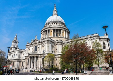 London, United Kingdom - April 17 2019: Tourists are walking in front of St. Paul Cathedral in London