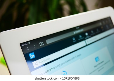 "London / United Kingdom - April 18 2018: LinkedIn social network website on the tablet computer. LinkedIn logo and search bar with title ""Search Jobs"" in focus. Close up shot of linkedin home page."