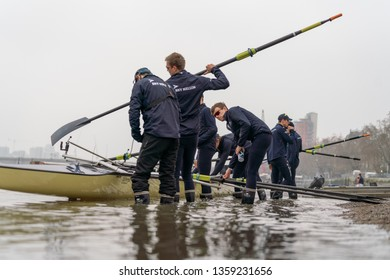 London / United Kingdom - April 2 : Oxford University Blue Boat out on the River Thames just a few days before The Boat Race 2019. Oxford Blue Boat boating at Putney Embankment.