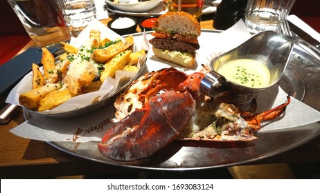 London, United Kingdom - April 2019 : Berger and Lobster with fries at Berger and Lobster restaurant