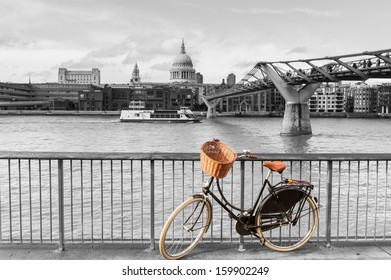 LONDON, UNITED KINGDOM � APRIL 22: Bicycle with wicker basket in color against the black and white backdrop of the Thames, St Paul's and the Millennium Footbridge (Wobbly Bridge) on April 22 in London