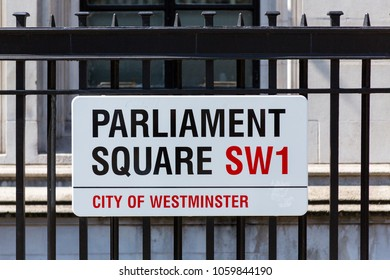 London, United Kingdom - April 23, 2015: A street sign hangs off a fence in central London in the City of Westminster