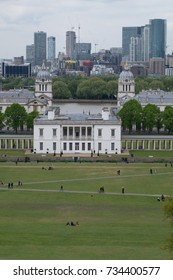 LONDON, UNITED KINGDOM - APRIL 29, 2017: view of Greenwich Park and the Queen's House, part of the National Maritime Museum, with the River Thames and the towers of Canary Wharf in the background.