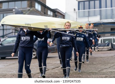 London / United Kingdom - April 3 2019: Oxford Womens' Blue Boat train on the Tideway with 4 days to go until they race Cambridge. Blue Boat boating at Putney Embankment.