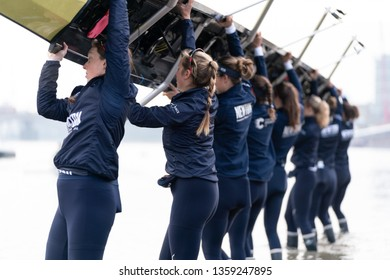 London / United Kingdom - April 3 2019: Oxford Womens' Blue Boat train on the Tideway with 4 days to go until they race Cambridge. Blue Boat boat from Putney Embankment.