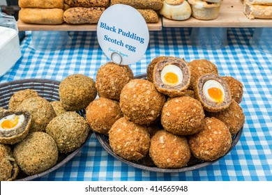 London, United Kingdom - April 30, 2016: Maltby Street Market in Bermondsey (located in railway arches, SE1, Rope Walk). Great artisan street food stalls and bars. Black pudding Scotch egg