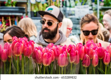 London, United Kingdom - April 30, 2017: Columbia Road Flower Sunday market. Street traders are selling their stock, people choosing flowers