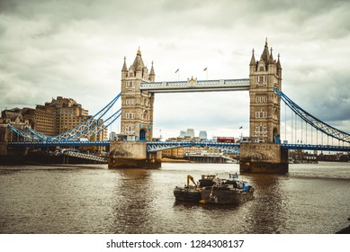 London - United Kingdom — April 7, 2017: the South Bank of the River Thames in Southwark, London, with the Tower Bridge in summer. Most tourist attractions in London are located near the river Thames