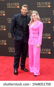 London, United Kingdom - April 7, 2019: Chris Robshaw and Camilla Kerslake  attend  The Olivier Awards at the Royal Albert Hall in London, England.
