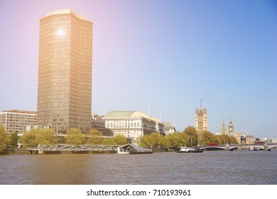 London, United Kingdom. April 9, 2017. View of Millbank Tower from Vauxhall Bridge, with Thames House, Big Ben, The Eye and The Palace of Westminster Visible in The Background