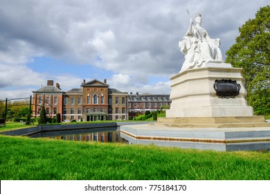 LONDON, UNITED KINGDOM - APRIL 9, 2017: Queen Victoria statue in front of Kensignton palace,  London, United Kingdon. The Queen was born at this palace on 24 May 1819.