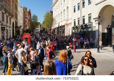 London, United Kingdom. April 9,2017. A lot of Tourists watching the magic performance on James Street, Covent Garden
