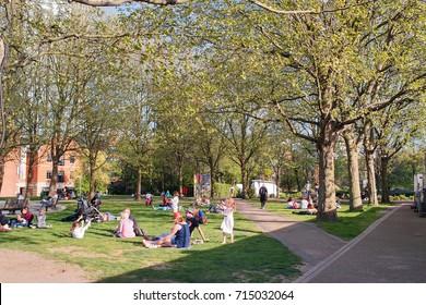 London, United Kingdom. April 9,2017. People Relaxing in The Bernie Spain Gardens