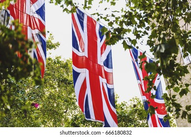 LONDON, UNITED KINGDOM - August 12th, 2016: Union Jack flag waving above Bruton Street in the affluent area of Mayfair in London city centre