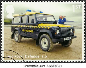 LONDON, UNITED KINGDOM - AUGUST 13, 2013: A stamp printed in United Kingdom shows Land Rover Defender, Coastguard, series Classic British Auto Legends The Workhorses, 2013