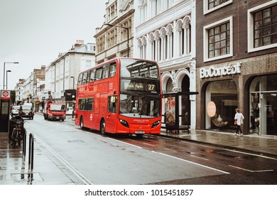 London, United Kingdom - August 18, 2017: The streets of London during the rain. Red phone boxes and red london buses. Summer in London