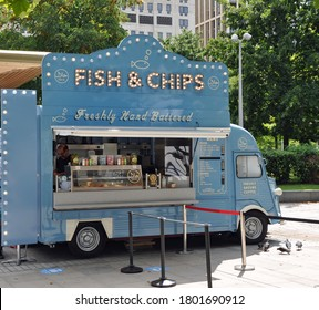 London, United Kingdom, August 2, 2020. Blue van selling fish and chips fast street food. Southbank of the River Thames. London, United Kingdom, August 2, 2020