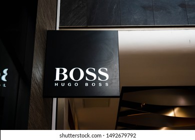 London, United Kingdom - August, 2019: Logo And Sign Or Signboard On Facade Boutique Hugo Boss. Luxury Store Hugo Boss In London UK. Fashion brand