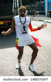 London, United Kingdom, August 25th 2019:-A  reveller at the Notting Hill Carnival in West London, the Notting Hill Carnival is Europe's largest street party.