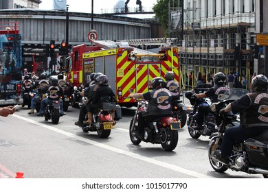London, United Kingdom - August 26 2017: A group of Hell's Angels motor bikers in London queue at traffic lights behind a fire engine.