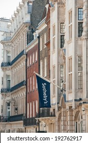 LONDON, UNITED KINGDOM - AUGUST 28, 2013: Sotheby's flag above London Office on New Bond Street on August 28, 2013. Sotheby's is one of the world's largest brokers of fine and decorative art, jewelry