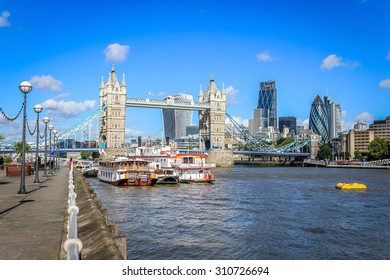 London, United Kingdom - August 28, 2015: Tower bridge and the City of London skyline. Shows 122 Leadenhall Street (Cheesegrater), 20 Fenchurch Street (Walkie talkie) and 30 St Mary Axe (Gherkin).