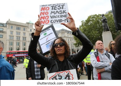 London / United Kingdom - August 29 2020: Anti-mask, anti-lockdown and anti-vaccine protesters stage a demonstration in Trafalgar Square.