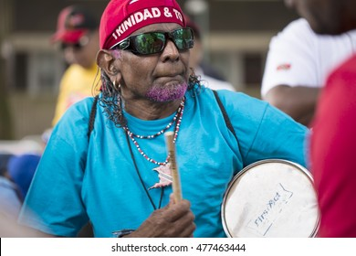 London, United Kingdom - August 29, 2016:  Notting Hill Carnival. Local residents sit up on Trini hill playing Trinidad rhythms together filling in time waiting for the parade to start.