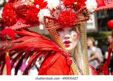 London, United KIngdom - August 29, 2016: Notting Hill Carnival. A group of performers at the carnival dressed in theme of Japan with elaborate costumes and makeup.