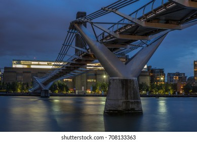 LONDON, UNITED KINGDOM - AUGUST 29, 2017: Millenium bridge in London at night  reflecting on the Thames - 2