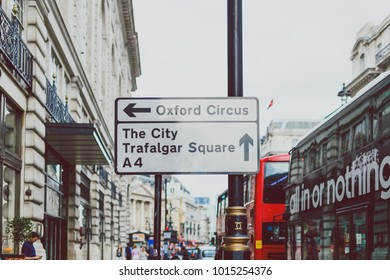 LONDON, UNITED KINGDOM - August 2nd, 2014: Oxford Circus city and Trafalgar Sqare street sign in London ciy centre with street bokeh