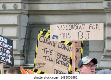 London, United Kingdom, August 31st 2019:- Protesters in Whitehall, London protesting Prime Minister Boris Johnson's plan to suspend Parliament for five weeks with insulting signs about sex acts