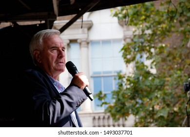 London, United Kingdom, August 31st 2019:- Labour's John McDonnell speaks to protesters in central London against Prime Minister Boris Johnson's plan to suspend Parliament for five weeks