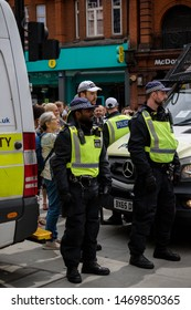 London, United Kingdom, August 3rd 2019:- Police block a street in London to prevent Tommy Robinson supporters and anti facist demonstrators clashing