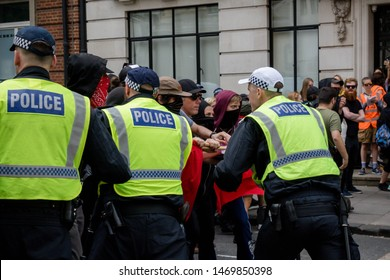 London, United Kingdom, August 3rd 2019:- Police scuffle with anti fascist demonstrators rallying in opposition to a rally by supporters of the former EDL leader Tommy Robinson