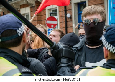 London, United Kingdom, August 3rd 2019:- Police draw battons to contro anti fascist demonstrators rallying in opposition to a rally by supporters of the former EDL leader Tommy Robinson