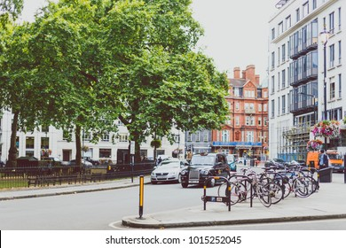 LONDON, UNITED KINGDOM - August 9th, 2014: Berkeley Square park in London city centre with bikes parked next to it