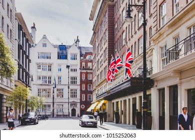 LONDON, UNITED KINGDOM - August 9th, 2014: beautiful streets with historical buildings in Mayfair, an affluent are of London city centre featuring The May Fair hotel