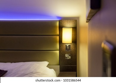London, United Kingdom - Circa February 2018: Shallow focus of modern LED ambient mood lighting seen in a modern apartment bedroom. The soft lighting acts to create a relaxing atmosphere.
