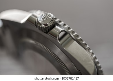 London, United Kingdom - Circa February 2018: Close-up, shallow focus image of a famous, Swiss manufactured men's diving watch showing detail of the watches Crown assembly in stainless steel.