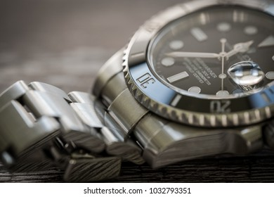 London, United Kingdom - Circa February 2018: Close-up, shallow focus of a luxury, Swiss manufactured men's mechanical diving watch showing part detail of the ceramic bezel and dial face.
