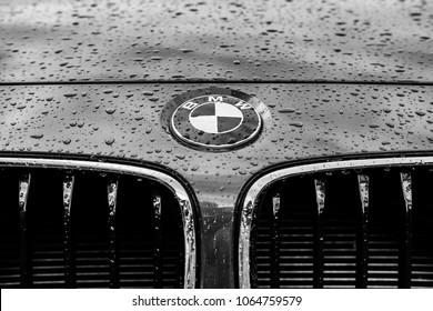 London, United Kingdom - Circa June 2016: Monochrome image of a luxury, german-made sports car showing details of its badge and grille area. Taken in a showroom after being cleaned with water.