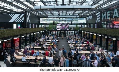 LONDON, UNITED KINGDOM - CIRCA MAY, 2018: People drinking and eating inside Boxpark pop-up food market in East Croydon.